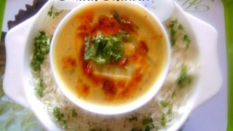 Serve kadi with chawal (White Rice)