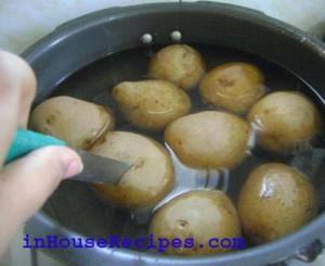 Poke knife in one of the potato