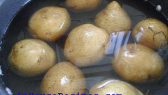 Add the Potatoes and 1 liter of Water in a pressure cooker.