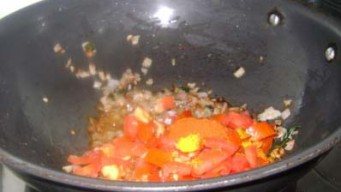 Add chopped Tomatoes, Turmeric Powder, Red Chili Powder & Salt