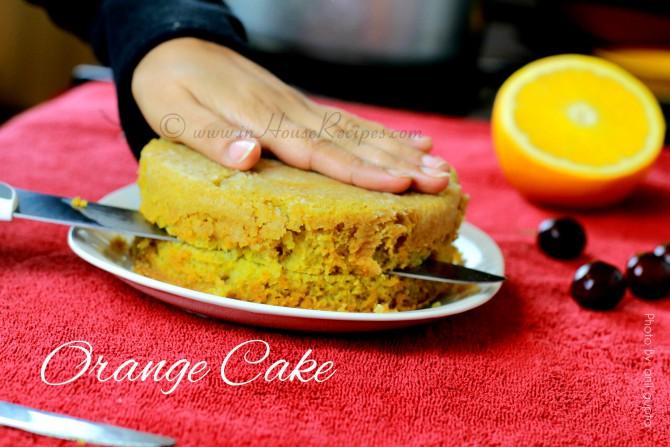 Slicing orange cake into 2 pieces for adding cream